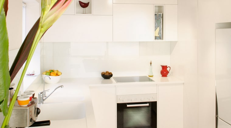 Kitchen with white walls and cabinetry. countertop, interior design, kitchen, living room, product design, room, wall, white