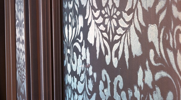 Closeup of stencilling on wall panel. curtain, design, interior design, pattern, textile, wall, wallpaper, wood, gray, black