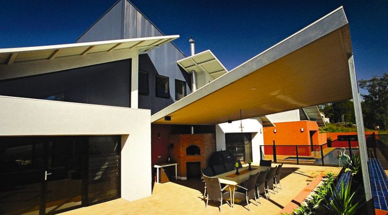 Large covered outdoor area of home, with dining architecture, facade, home, house, real estate, roof
