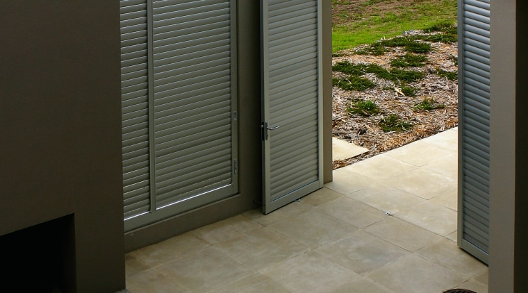 A view of some outdoor tiling. architecture, floor, flooring, home, house, property, real estate, tile, wall, gray, black