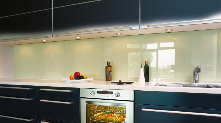Kitchen with black cabinetry, long handles, green splashback cabinetry, countertop, home appliance, interior design, kitchen, kitchen stove, major appliance, under cabinet lighting, black