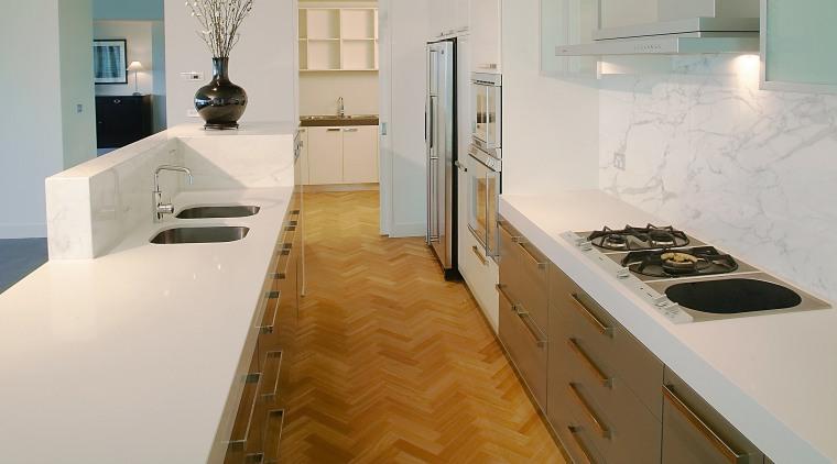 A view of a Far East Consortium apartment cabinetry, countertop, floor, flooring, hardwood, interior design, kitchen, laminate flooring, real estate, room, tile, wood flooring, gray, brown
