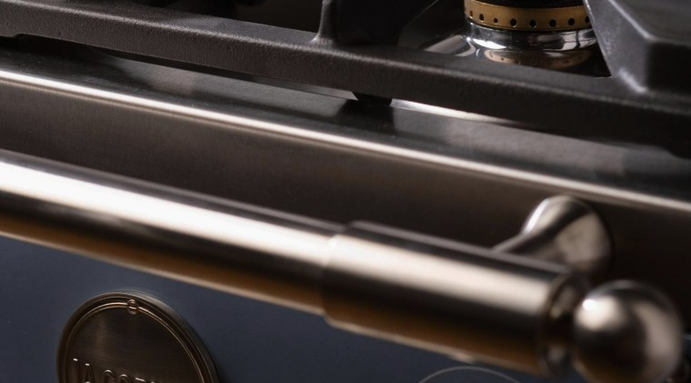 Closeup view of cooktop and control handles for black