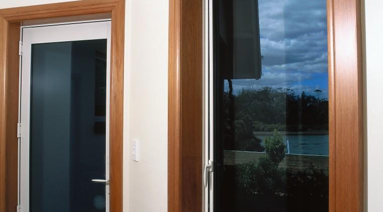 Aluminium joinery windows with timber surround. door, interior design, window, white, brown