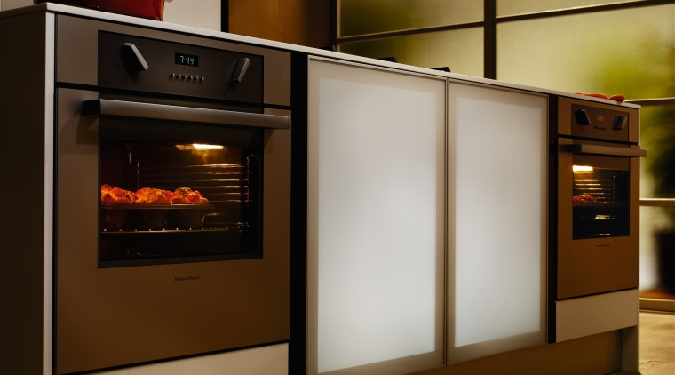 A view of some Fisher & Paykel appliances. home appliance, kitchen, kitchen appliance, kitchen stove, major appliance, microwave oven, oven, brown