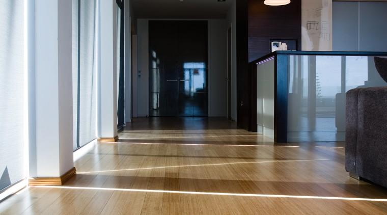 Bamboo timber flooring in apartment. apartment, floor, flooring, hardwood, interior design, laminate flooring, wood, wood flooring, gray, brown