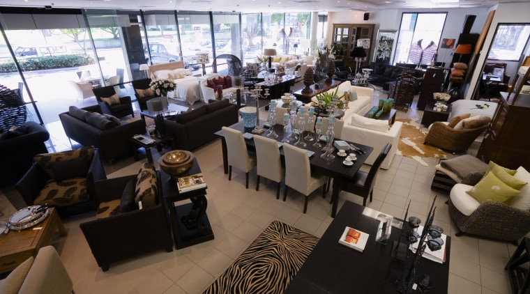 View of showroom with mix of furniture settings restaurant, black