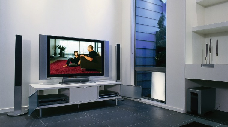 Lounge room with large flat screen tv with floor, furniture, hearth, interior design, living room, table, black, gray