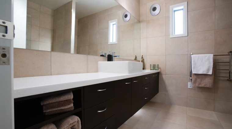 view of this clean smooth bathroom, the large architecture, bathroom, bathroom cabinet, cabinetry, countertop, floor, flooring, home, interior design, kitchen, property, real estate, room, sink, tile, gray