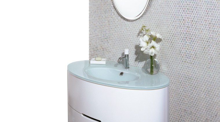 view of this streamlined contemporary bathroom, oval vanity angle, bathroom, bathroom accessory, bathroom cabinet, bathroom sink, ceramic, plumbing fixture, product, product design, purple, tap, toilet seat, white, gray