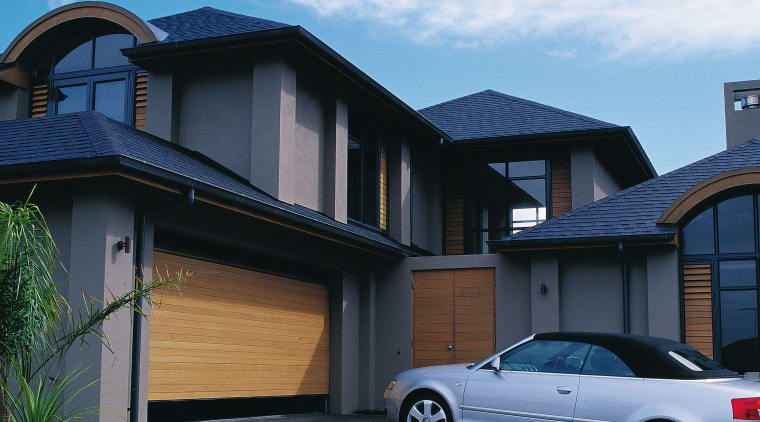 A view of a timber garage door by architecture, automotive exterior, building, car, elevation, estate, facade, family car, home, house, luxury vehicle, mid size car, motor vehicle, property, real estate, residential area, siding, suburb, window
