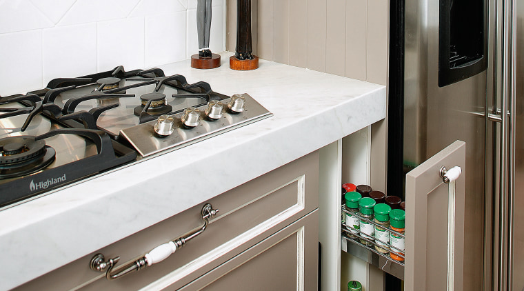 View of cooktop and kitchen cabinetry with storage countertop, furniture, home appliance, interior design, kitchen, kitchen appliance, major appliance, room, gray