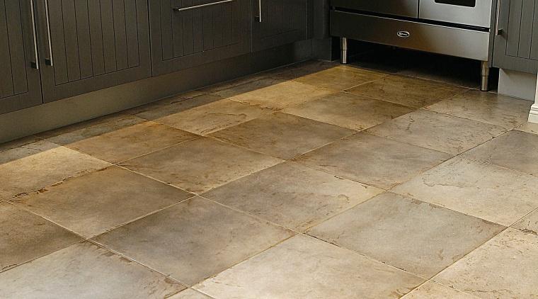 A view of a tiled floor from Quantum floor, flooring, hardwood, home, laminate flooring, tile, wood, wood flooring, orange, black