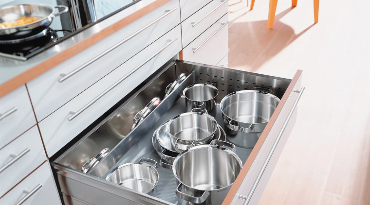 View of kitchen cabinetry and large pull out countertop, drawer, floor, furniture, kitchen, kitchen appliance, kitchen stove, product design, sink, table, white