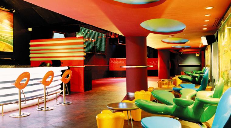 view of the interior of the zouk nightclub interior design, restaurant, table, yellow
