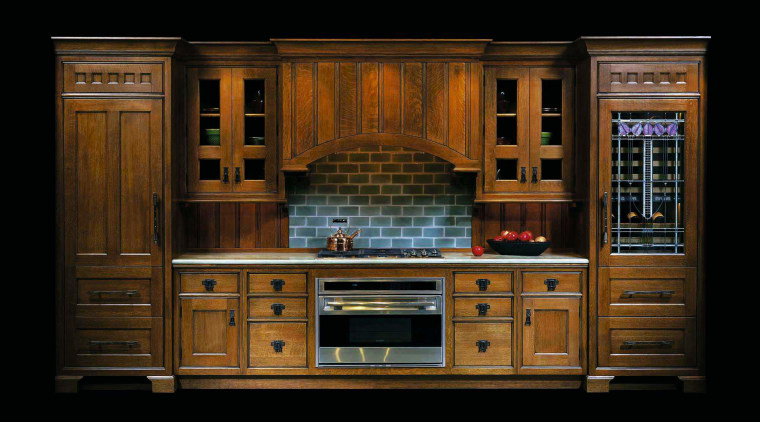 view of this kitchen featuring stained wood cabinetry, cabinetry, cupboard, furniture, hardwood, kitchen, wood, wood stain, black, brown