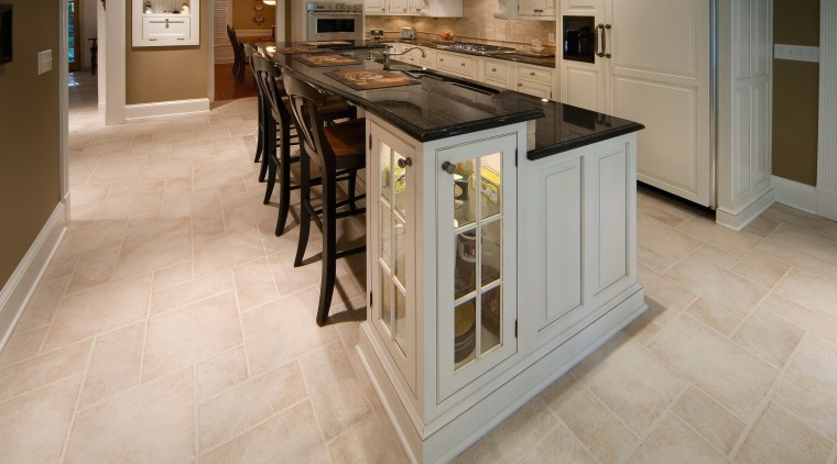 A view of a kitchen by Kitchenworks. cabinetry, countertop, cuisine classique, floor, flooring, hardwood, kitchen, laminate flooring, tile, wood flooring, gray, brown