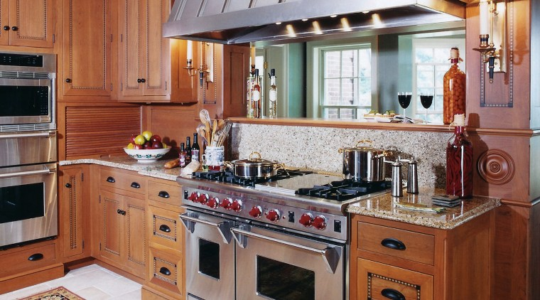 A view of a kitchen by Kitchen & cabinetry, countertop, cuisine classique, furniture, interior design, kitchen, room, red