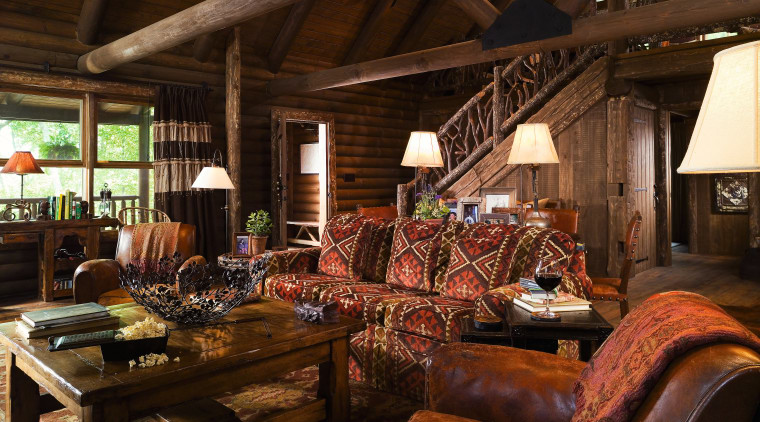 view of the lounge/entrance in this vacation home home, interior design, living room, room, brown