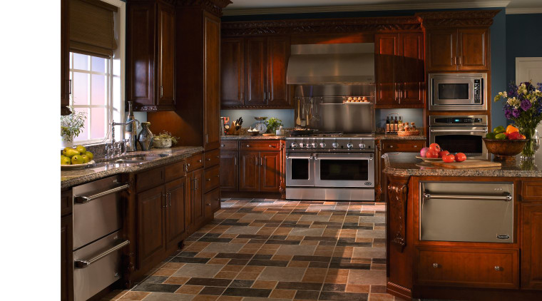 view of the kitchen featuring a DCS stainless cabinetry, countertop, cuisine classique, floor, flooring, hardwood, interior design, kitchen, room, wood flooring, brown