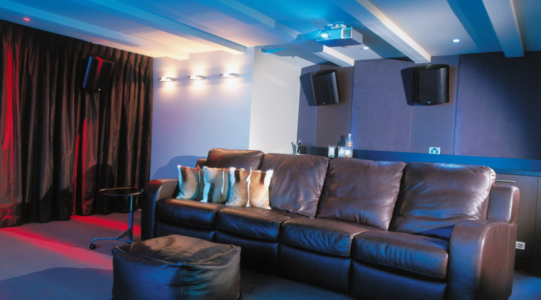 view of the theatre featuring brown leather furniture, blue, ceiling, home, interior design, lighting, room, blue