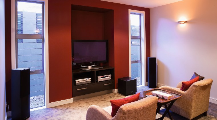 View of home theatre room with armchairs and home, interior design, living room, real estate, room, suite, red