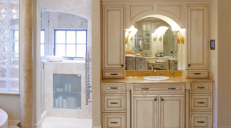 A view of a kitchen and bathroom by bathroom accessory, bathroom cabinet, cabinetry, countertop, cuisine classique, floor, furniture, home, interior design, kitchen, room, window, gray, brown
