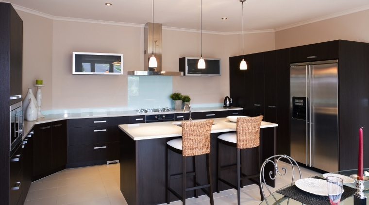 This kitchen features dark chocolate-coloured cabinetry and smeg cabinetry, countertop, cuisine classique, interior design, kitchen, property, real estate, room, gray, black