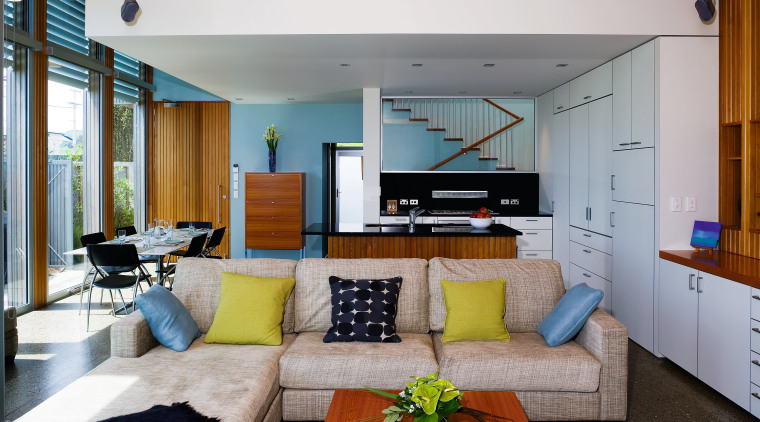 A view of this living area where the architecture, house, interior design, living room, real estate, gray