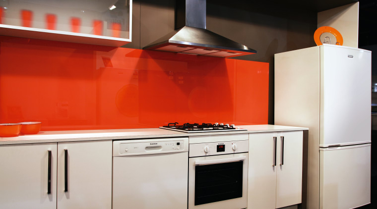 A view of some Simpson kitchen appliances. cabinetry, countertop, home appliance, interior design, kitchen, kitchen appliance, kitchen stove, major appliance, orange, product, product design, room, gray