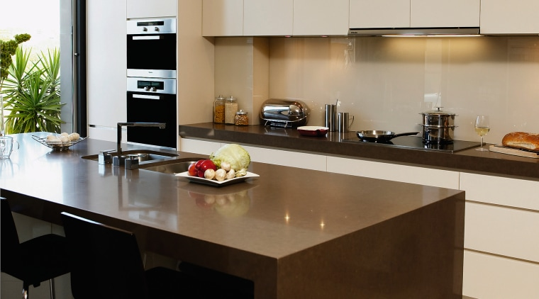 View of this modern kitchen designed by DK countertop, interior design, kitchen, brown, gray