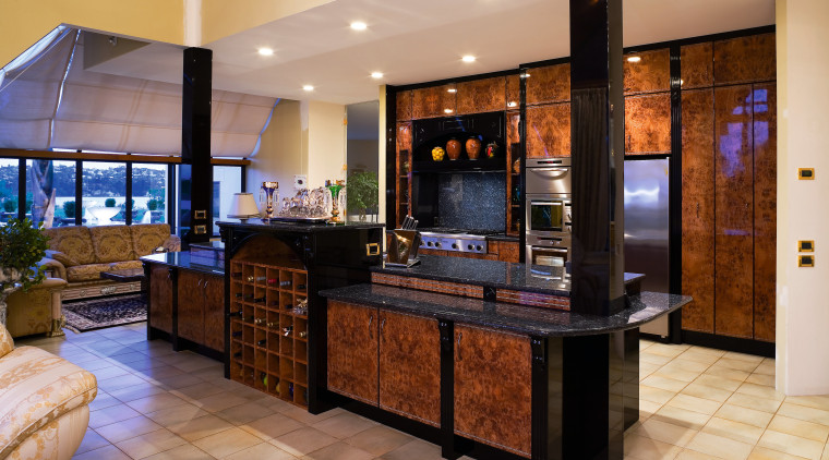 View of this kitchen featuring tiled flooring, lacquered countertop, flooring, interior design, kitchen, lobby, real estate, room, orange, brown
