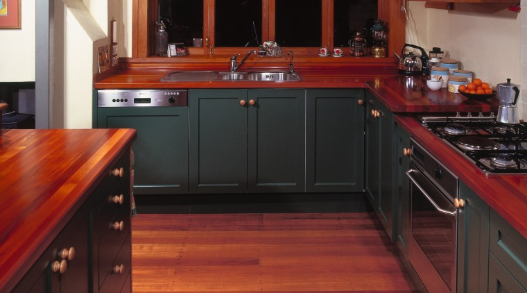 A view of some kitchen cabinetry by Kings cabinetry, countertop, cuisine classique, floor, flooring, furniture, hardwood, interior design, kitchen, room, wood, wood flooring, wood stain, red, black