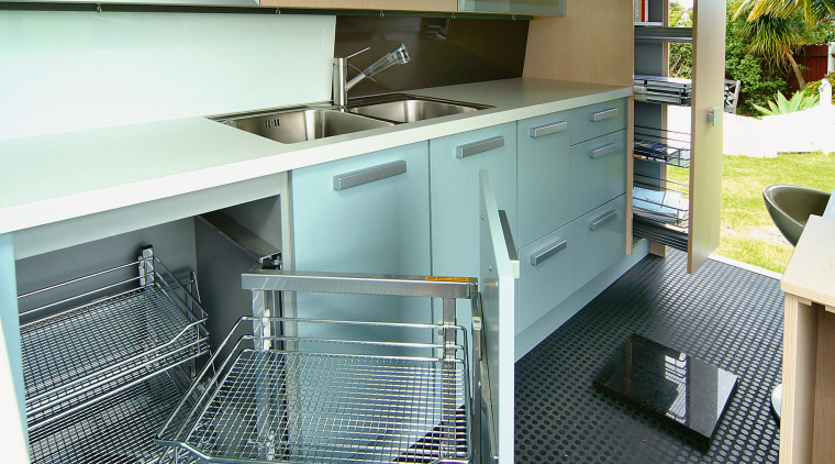 A view of a kitchen by the Mobile countertop, kitchen, white