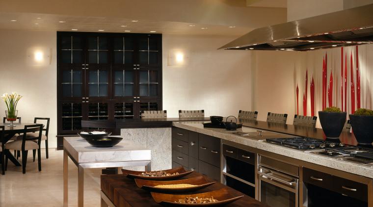 A view of this new de Giuilo kitchen cabinetry, ceiling, countertop, floor, flooring, hardwood, interior design, kitchen, lighting, room, under cabinet lighting, wood flooring, brown