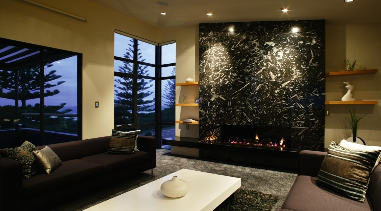 A view of a fireplace from Living Flame. ceiling, home, interior design, lighting, living room, lobby, room, wall, black, brown