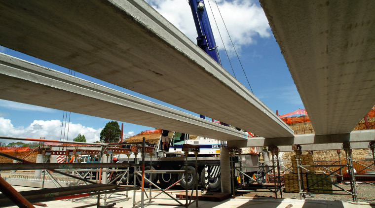 A view of some reinforced concrete planks from architecture, bridge, fixed link, metropolitan area, overpass, sky, skyway, structure, transport, brown