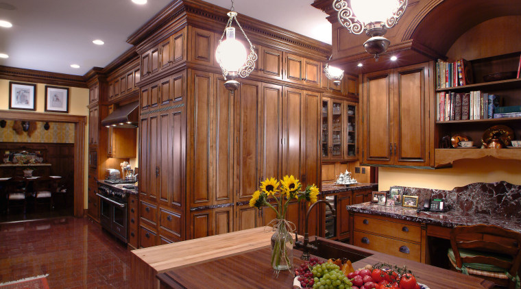 A view of this kitchen features cabinets by cabinetry, ceiling, countertop, cuisine classique, hardwood, interior design, kitchen, living room, real estate, room, wood, red, brown