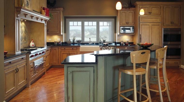 View of this traditional kitchen featuring grean teak cabinetry, countertop, cuisine classique, floor, flooring, hardwood, interior design, kitchen, room, wood flooring, brown
