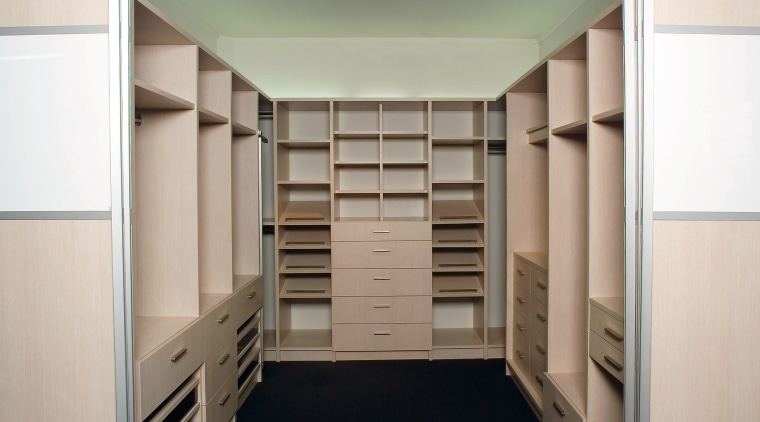 A view of the Walk in wardrobe featuring cabinetry, closet, cupboard, furniture, wardrobe, white