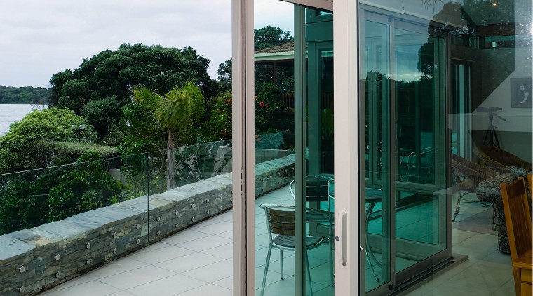 A view of some aluminium joinery by Phoenix architecture, door, glass, window, gray