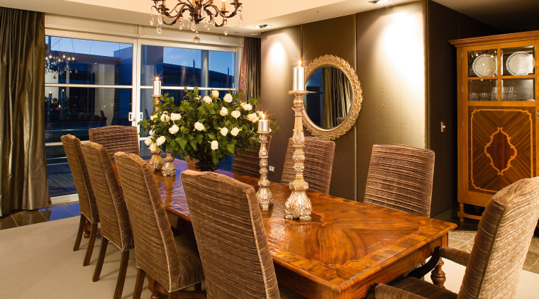 Comfortable proporations and vlean lines are evident in dining room, furniture, interior design, living room, room, table, brown, orange