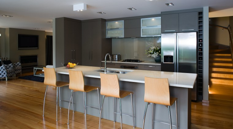 A view of some kitchen appliances from Electolux. countertop, floor, flooring, hardwood, interior design, kitchen, real estate, room, table, wood flooring, gray