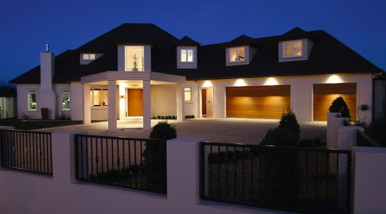 A view of this home hiding the facade architecture, building, elevation, estate, facade, home, house, lighting, property, real estate, residential area, window, black, blue