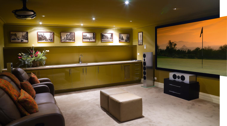 A view of the home theatre. ceiling, interior design, lighting, living room, lobby, room, brown