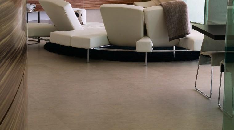 A view of this apartment featuring zMonaco Brown floor, flooring, furniture, hardwood, interior design, laminate flooring, living room, table, tile, wood, wood flooring, brown, gray