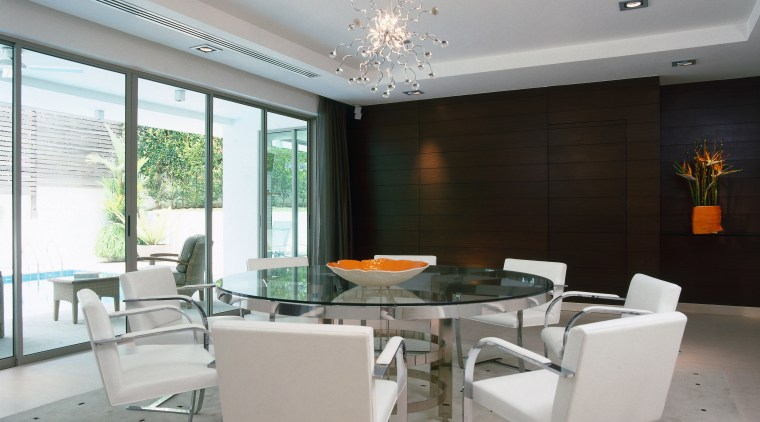 A view of the dining room feature teak ceiling, dining room, interior design, living room, real estate, table, gray