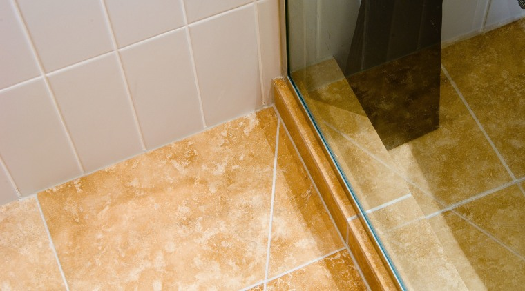 A view of some bathroomware from Newline Bathroomware. bathroom, floor, flooring, hardwood, room, tile, wall, orange, gray