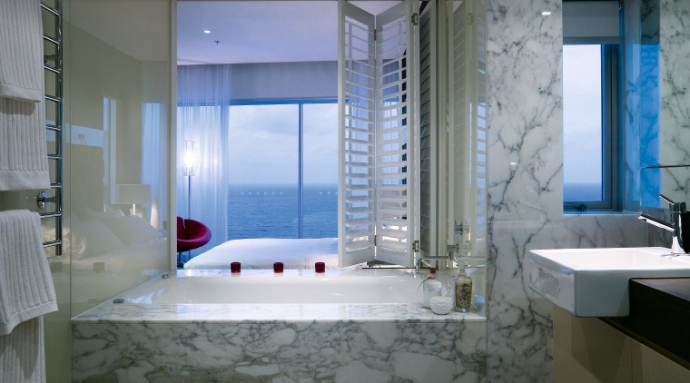 A view of the bathroom featuring marble tiles, bathroom, interior design, room, suite, gray