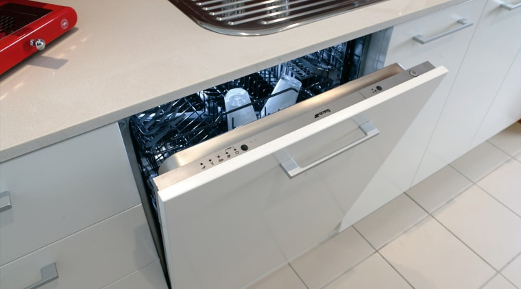 The intergrated dishwasher helps to give the kitchen automotive exterior, countertop, floor, home appliance, kitchen, kitchen stove, major appliance, gray